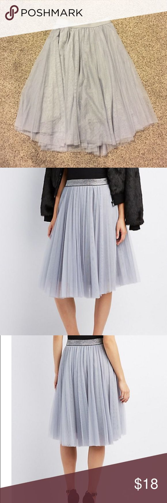 NWT tulle skirt in a silvery gray This skirt is brand new, hits midi length. Beautiful tulle material with elastic waistband Charlotte Russe Skirts