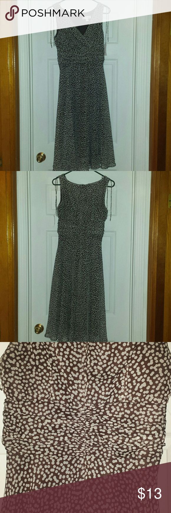 Classic polka dot dress This sweet and classy polka dot dress is flattering for any body shape, with a ruched waist, v neckline, and flowy skirt. Brown with white polka dots. New with tags. Dress Barn Dresses