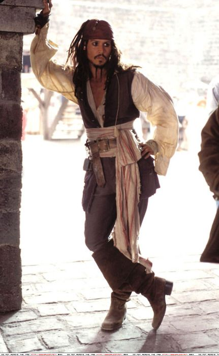 """Pirates of the Caribbean: The Curse of the Black Pearl,"" 2003  Costume design: Penny Rosedistressed 12-button aubergine linen vest, cream linen shirt, brown cotton button-fly pants with buttoned, buckled cuffs and brown suede knee-high boots with 10-inch cuffs - worn by Johnny Depp in the role of Captain Jack Sparrow"