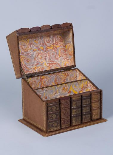 leather trompe l'oeil fake books letter box, lined with marbled paper