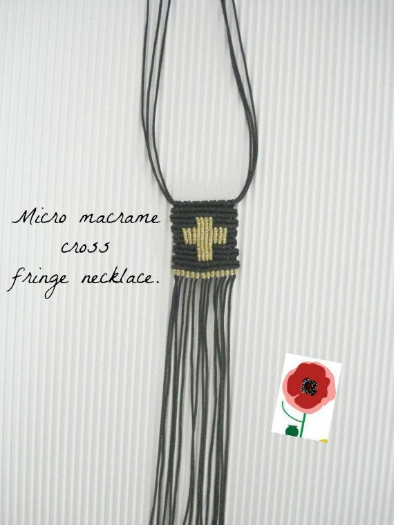 Fringe necklace with gold cross.