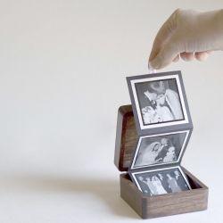 Create a custom keepsake using a pine box, scrapbook paper, glue, ribbon, and a few pictures.  Great DIY gift idea.