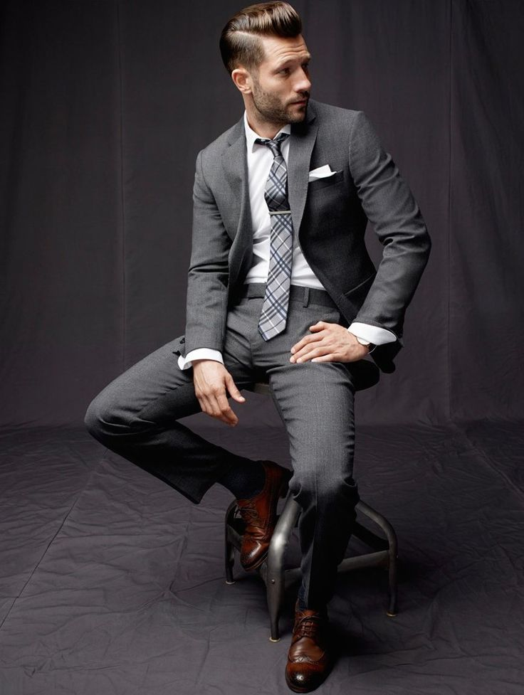 If you work in a more high-fashion friendly business professional workplace a slim cut suit with a surprising shoe can make the uniformity a little more interesting.