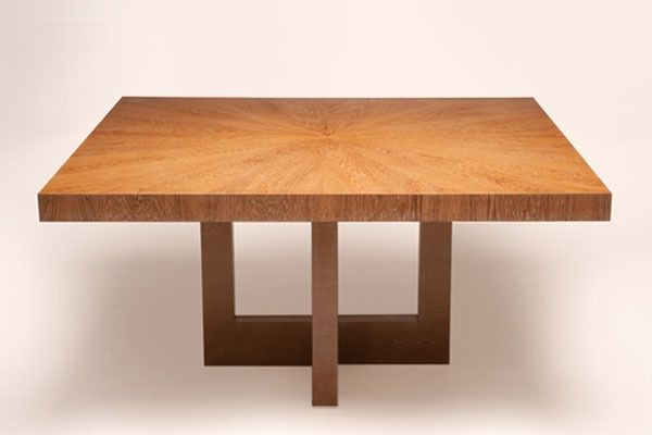 This elegant square dining table in teak with an airy base design and a sunburst pattern top is the perfect addition to any modern dining area.