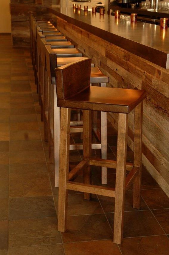Low back barstools made of solid wood perfect for an indoor bar area.  Love the bar itself even more.