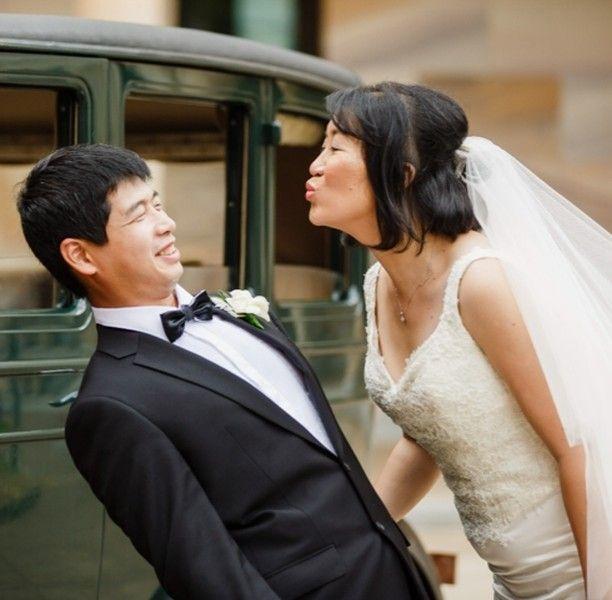 When the groom gets a bit cheeky!. . . . . . #cheekygroom #asianwedding #UQ #BrisbaneWeddingPhotographer  #momentdesign #thiskindoflove #designyourmoments #cleverbeanproductions #roaringtwentiesvintagecarhire #wedding #kisses