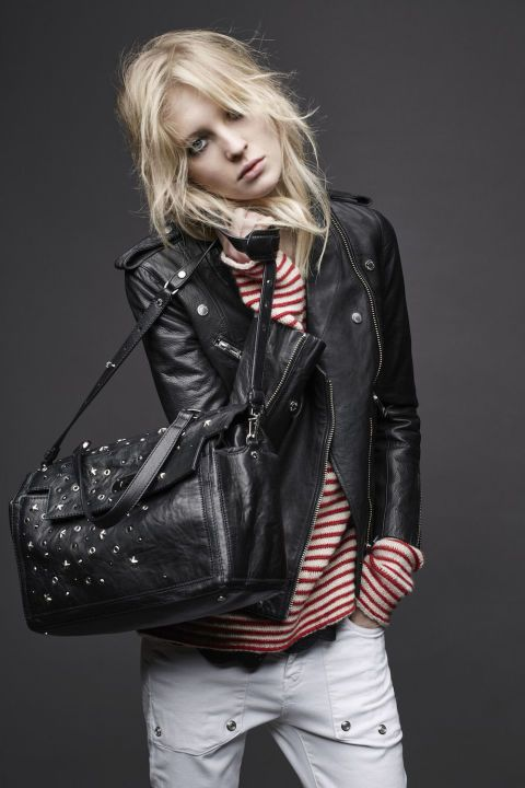 """A rich moto jacket and studded purse add some edge to prepster stripes and white jeans. """"When I imagine a true Parisian girl, I see her like this, wearing a boyfriend sweater and a leather jacket,"""" Bönström says. Extra-long sleeves on the nautical top make it an easy autumn go-to."""