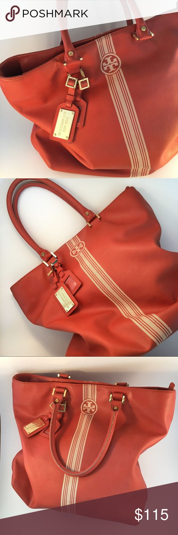 Authentic Tory Burch orange Tote bag GUC Authentic Tory Burch orange leather tote bag. Tan and gold accents. GUC. Shows slight wear and a few pen markings on the bottom of the lining on the inside (pictured). Beautiful bag, great color for late summer/early fall! Tory Burch Bags Totes