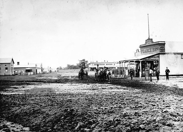 The main street in Jeparit with Pearce Brothers store on the right and Hopetoun House in the background, c1895