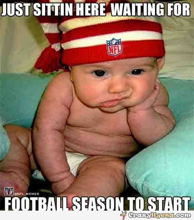 Cutest+baby+sitting+in+front+of+the+TV+and+wearing+an+NFL+hat+and+looking+very+bored+and+tired+of+waiting+for+the+new+season+to+start= ADORABLE!!!