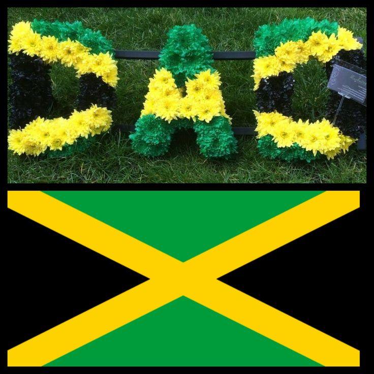 DAD letters funeral tribute in Jamaican flag theme www.enchantedflowersbynatalie.co.uk www.facebook.com/enchantedflowersbynatalie