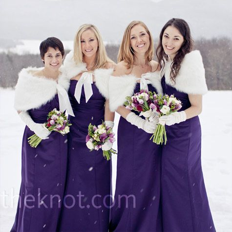 The Bridesmaids Wore Floor Length Plum Dresses And Kept Warm In White Faux