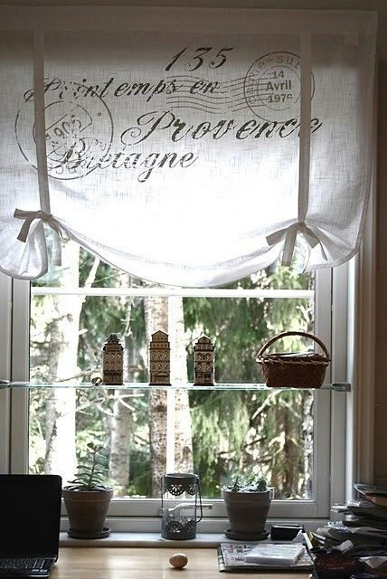 Style of curtains for office.  With shelf for plants. Ribbons to hold it up