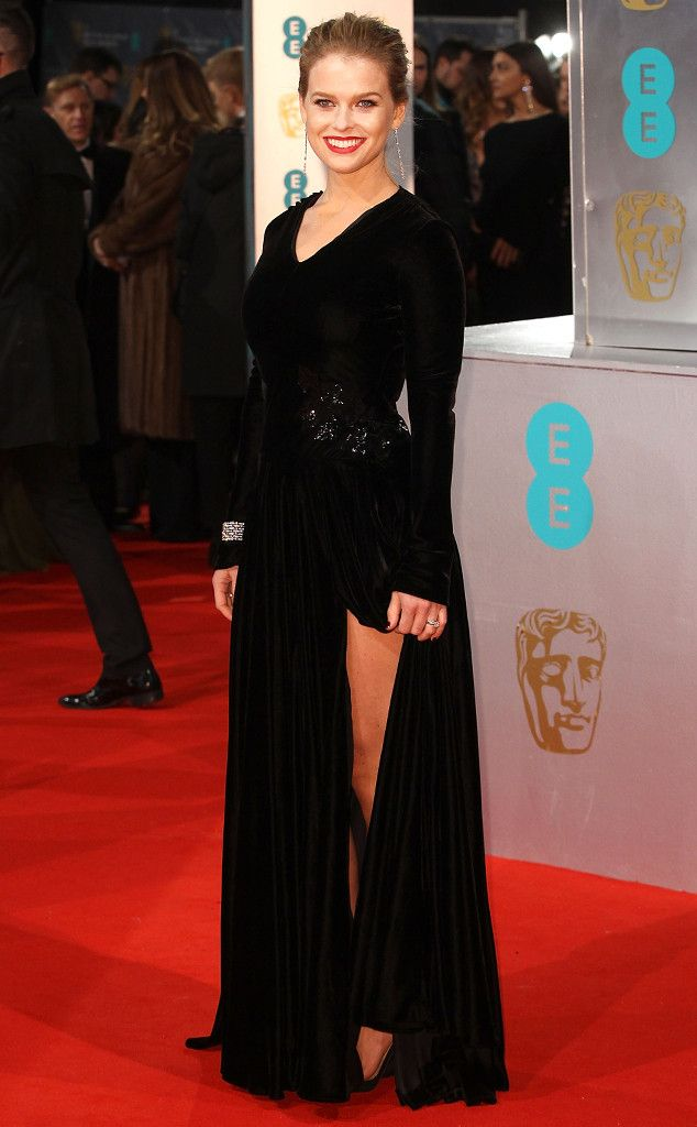 Alice Eve from 2015 BAFTA Film Awards: Red Carpet Arrivals  The newlywed showed off her gorgeous gams in a black gown that featured a thigh-high slit.