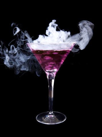 Purple Rain ~ 1 oz Vodka 1 oz Blue Curaçao 1 oz Coconut Rum ½ oz Lemon-Lime Soda Splash of Grenadine Half fill a shaker with ice. Pour in the Vodka, Blue Curaçao, Coconut Rum and Lemon-Lime Soda. Stir or shake gently. Pour into a glass. Add the Grenadine over the top. As the red of the Grenadine drips down the blue drink you should get the impression of purple rain.