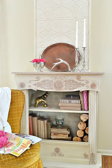 DIY old bookcase and footboard pieced together creates this beautiful faux fireplace
