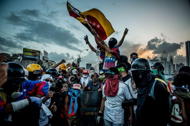The Battle for Venezuela Through a Lens Helmet and Gas Mask