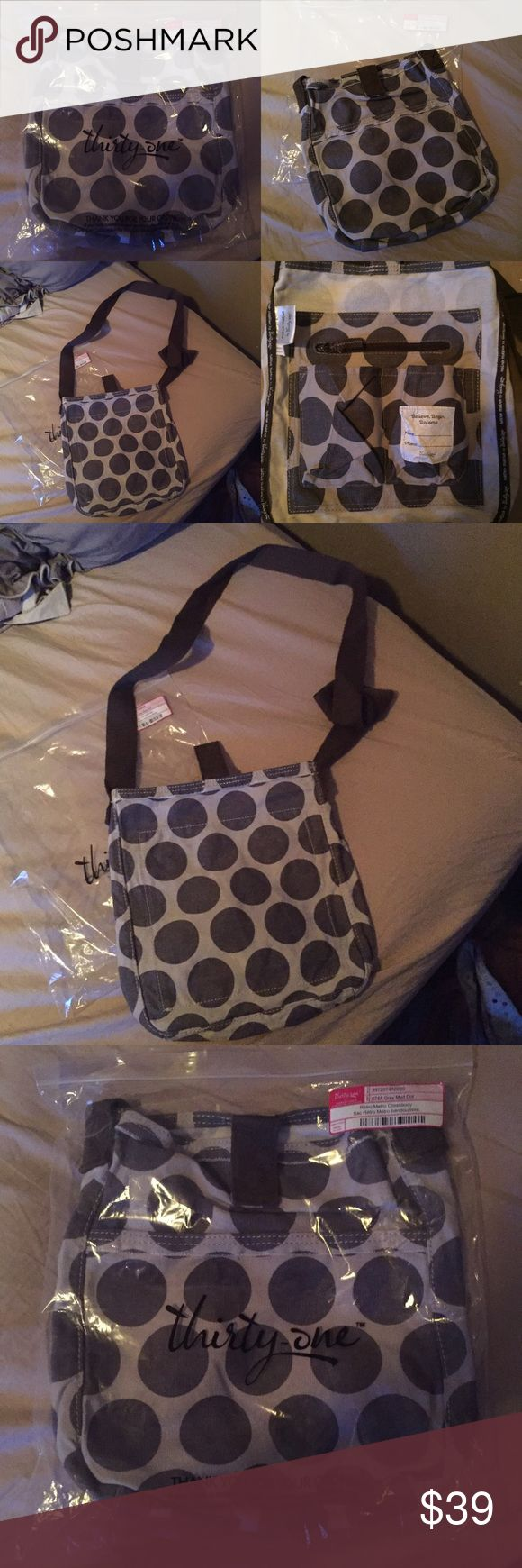 31 Retro Metro Crossbody Grey Mod Dot 1-HR SALE! Thirty-One Retro Metro Cross Body bag in Grey Mod Dot (Retired print and product) this item is brand new in original packaging was only taken out to take photos ! Also have the matching All-Day Organizing Tote ! Bundle and save! Thirty One Bags Crossbody Bags