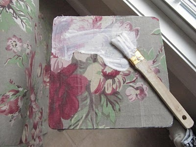 fabric and 2 layers of modge podge transforms a table to fit any room