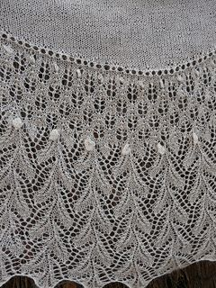 I set out to design a Crescent shawl that had more depth to it, more of a shawl than a bordered scarf, yet using short rows to give it shape.