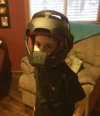 9yr old kid in Iron man motorcycle helmet
