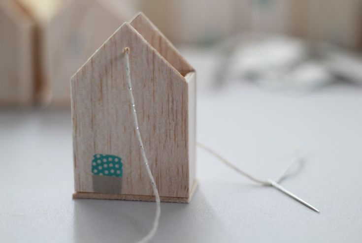 Make houses out of balsa wood (you can cut it with scissors) - link shows an advent calendar