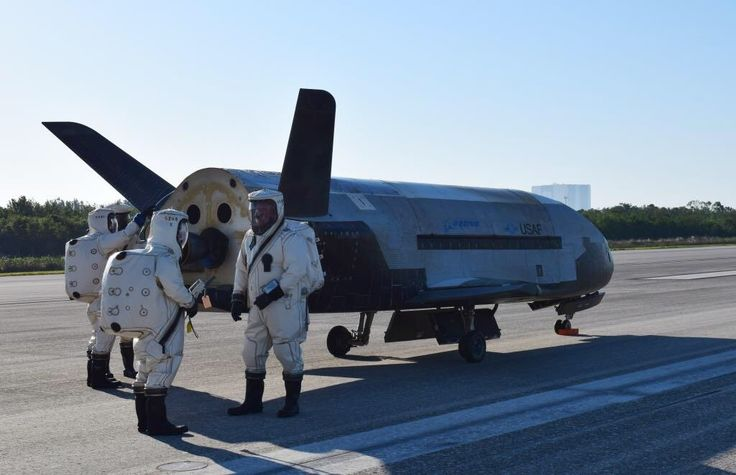 Personnel inspect the Boeing-USAF unmanned spacecraft X-37B/OTV4 at Kennedy Space Center on May 7 2017 after a record-breaking 718 days in orbit [1024x662]