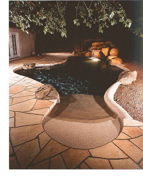 Another Small Pool with Beachfront entry and a lighted waterfall.  Perfect for my small yard.