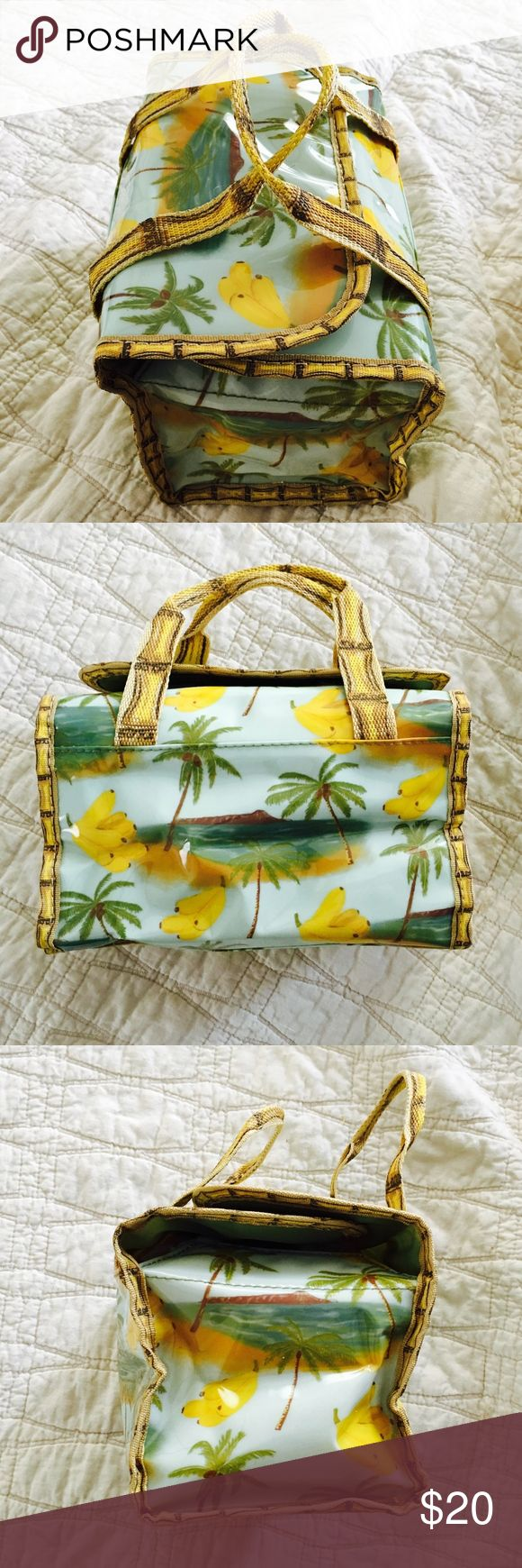 """vintage AVON Bag Really adorable and fun vintage AVON bag.  Can be used to carry lunch, drinks to the beach, makeup, toiletries.  Great for a fun day out or vacation!  Print is of bananas and palm trees set against a blue sky with bamboo print trim and handles.  Gets you in the mood, right?  8"""" x 5"""".  Has a few tiny little nicks but overall condition is new. Avon Bags Cosmetic Bags & Cases"""