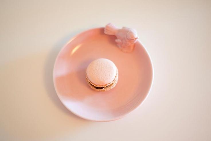Soft shade of pink. Macarons filled with a dark tuttifrutti flavored ganache.  Photo by Desiré Östergren.