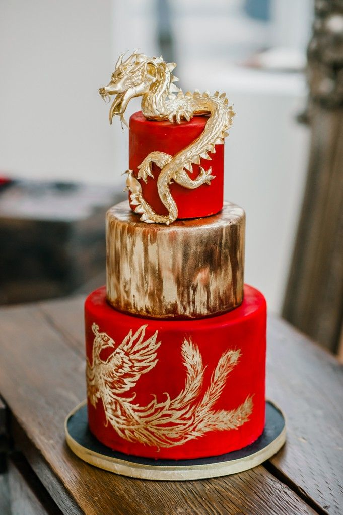 Opposites Attract #Cake. Would that be a dragon & peacock?