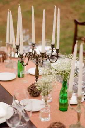 candleabra centerpieces with baby's breath in milk glass vases instead of the green bottles