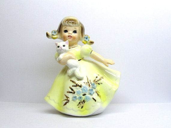 Adorable little girl clutching her white kitty cat ceramic figurine by Lefton. She is from their Marikas Original line, model #4668. Incised