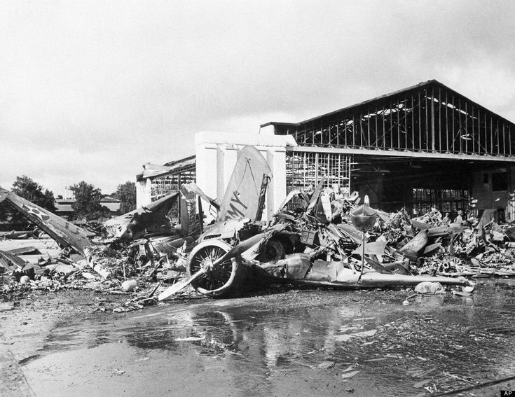 In this photo provided by the Department of Defense, U.S. aircraft destroyed as a result of the Japanese bombing on Pearl Harbor is shown, D...