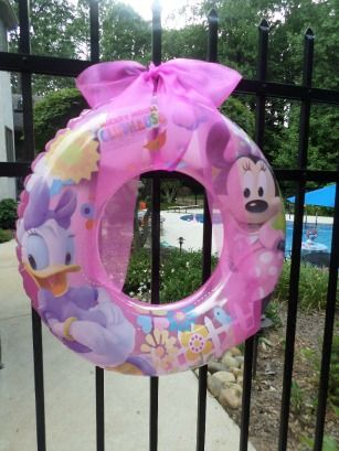 Hang a Minnie Swim Ring on the Gate to set the theme for your Minnie Mouse Pool Party.