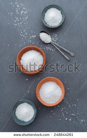 Salt in rustic ceramic bowls, top view
