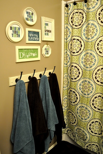 Bathroom re-do...coat hanger for towel rack & DIY signage...cute and smart!