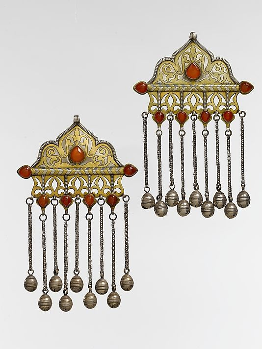 """""""Central Asia or Iran   Pectoral Ornament   late 19th–early 20th century   Silver, fire-gilded and chased, with decorative wire, openwork, cabochon carnelians, wire chains, and bells."""" Metropolitan Museum in New York BUT the Wolf collection and the book have been severely criticised by several connoisseurs ~ http://www.facebook.com/photo.php?fbid=10150376394673049=a.365927863048.151707.365830083048=3"""
