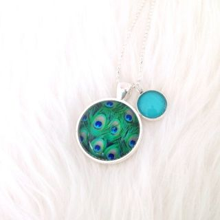 This gorgeous pendant is exclusive to Brindie! Featuring a hand-imaged 25mm glass dome set in a lead and nickel free silver tone tray, complimented by a turquoise 12mm mini pendant, this necklace is perfect to wear to the park, to work or out for a swish dinner. So versatile!   The chain is a fine 62cm silver tone ball chain which will hang to mid chest.     Each necklace will arrive in its own little cotton bag for gorgeous gifting and to keep the necklace tucked up safely when not in use…