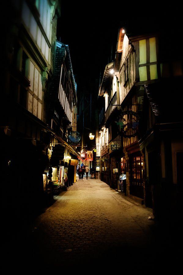 Nighttime street scene in Mont-Saint-Michel, France.
