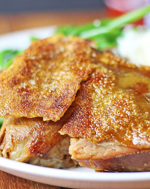 Crispy Cracklin' Pork Shoulder is pull apart tender with skin so thin & crisp you can shatter it with a fork. Made in a slow cooker & oven.
