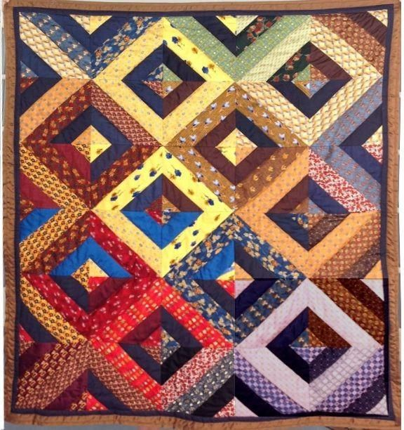 "Silk tie quilt. This is more ""planned"" than the strip piecing I do, but I like it for a change. Nice colors, too."