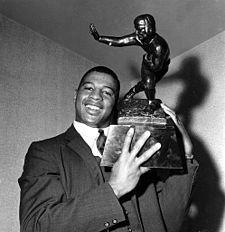 Ernie Davis holding his Heisman Trophy