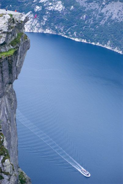 """Sometimes you come across a photo in Fotolia's catalog which literally makes your jaw drop. Fredrik Schlyter's image 'Man making a base jump' did just that. So we had to speak with him to find out the story behind it: """"Lysefjorden in Norway has been a favourite place for me for many years not only […]"""