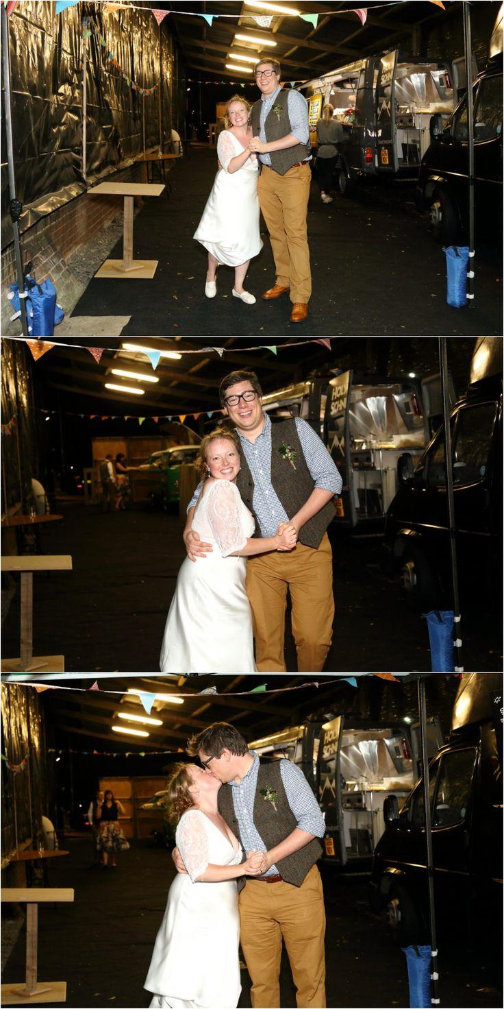 bride and groom wedding photography amongst street food vans as fun Childerley wedding, cambridge