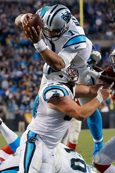 Quarterback Cam Newton #1 of the Carolina Panthers scores a touchdownagainst the Ariz ona Cardinals during the NFC Championship Game at Bank of America Stadium on January 24, 2016 in Charlotte, NC.