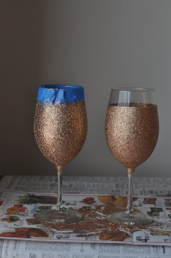 Create easy glitter wine glasses. Sooo cute. I wouldn't do the gold glitter. I'd do silver, and possibly red. (: