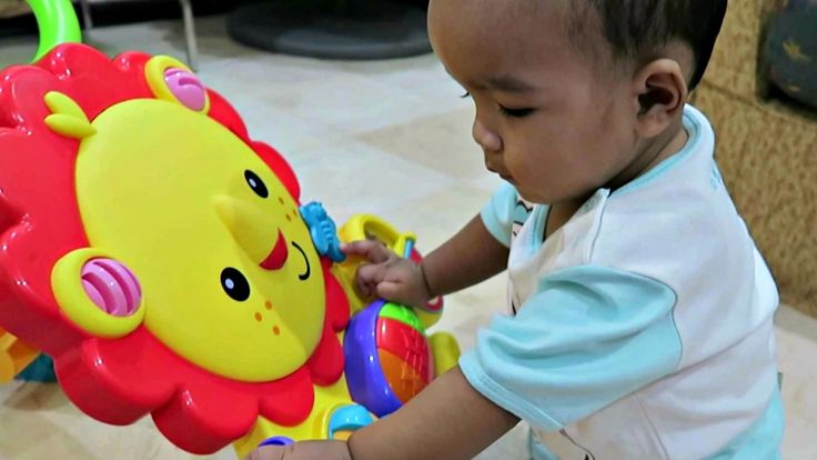 Playing with Lion Musical Walker by Fisher Price