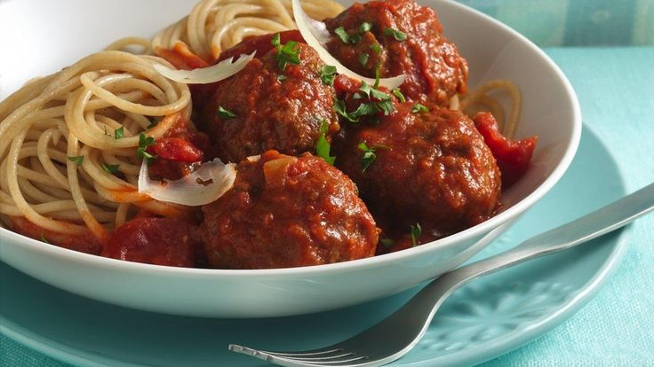 Spicy Parmesan Meatballs With Spaghetti recipe and reviews - Who knew pasta could be so good for you? Make meatballs with high-fibre cereal, and serve them over delicious whole wheat pasta.