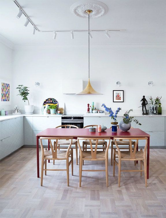 red dining table and yellow pendant lamp with pale blue kitchen cabinets. / sfgirlbybay